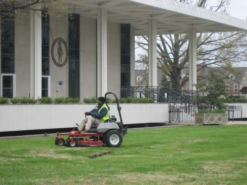 Mowing in front of City Hall